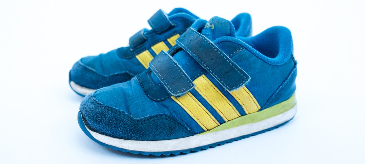 A pair of blue child's training shoes