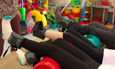 Children doing foot exercises for physiotherapy