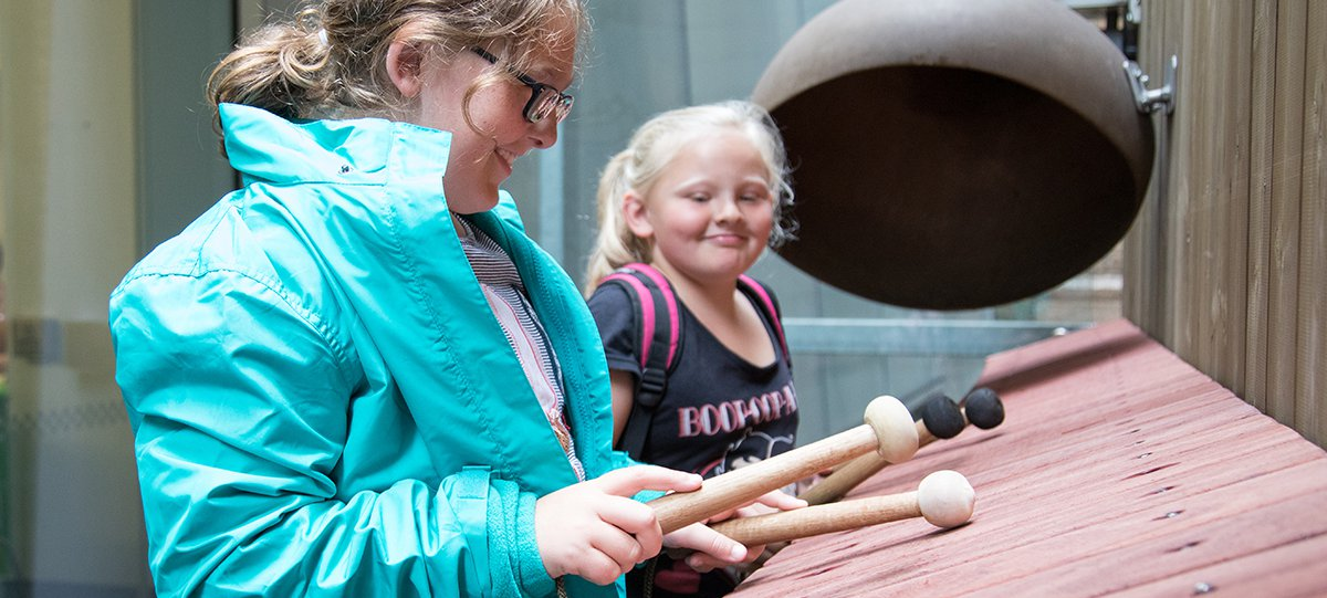 Two young girls playing the xylophone at the Lullaby Factory