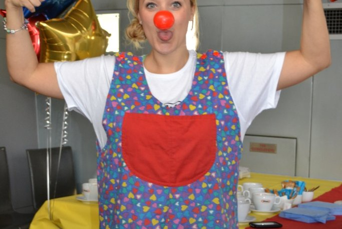 Volunteer with bunny ears and a red nose