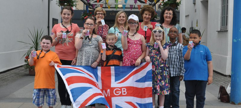Photo of GOSH patients outside the hospital entrance