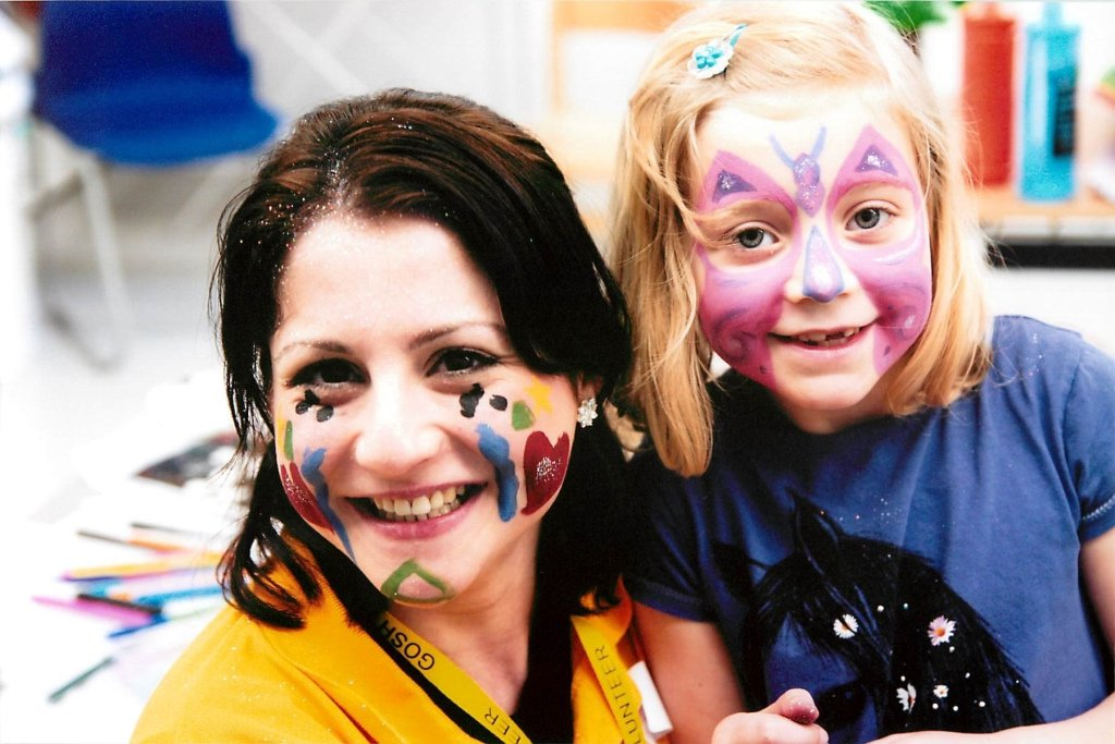 Children face painting with volunteers