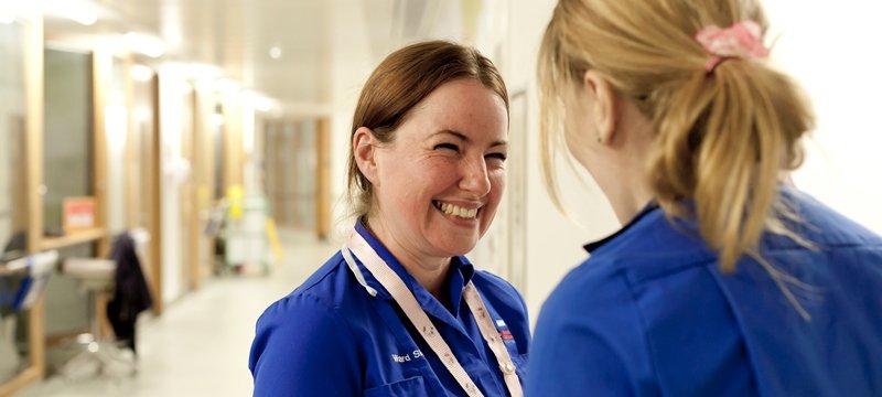 Nurses talking on ward corridor