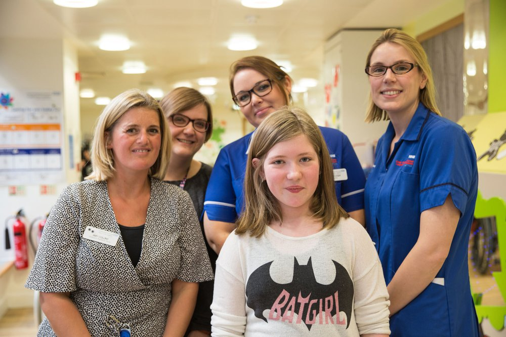 GOSH research patient with her medical team in the Somers Clinical Research Facility (CRF)