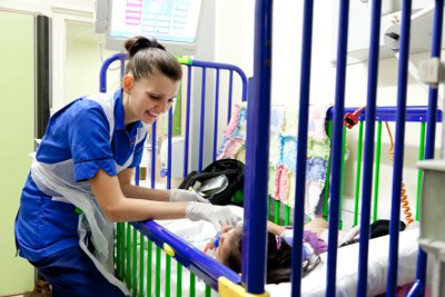 Nurse with a patient on Rainforest Gastro Ward