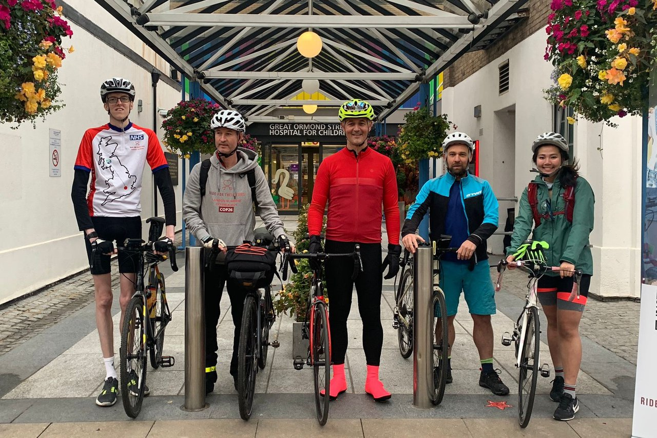 GOSH riders smile from GOSH entrance, ready to begin their 540 mile adventure.