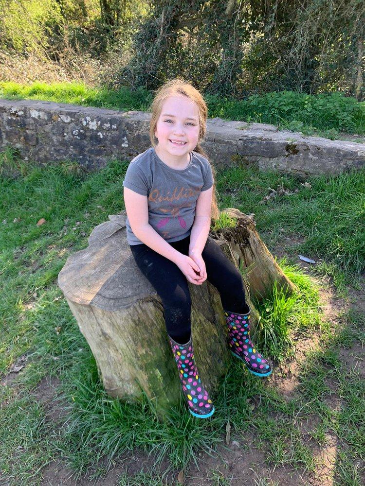 Patient Sara sat on a rock