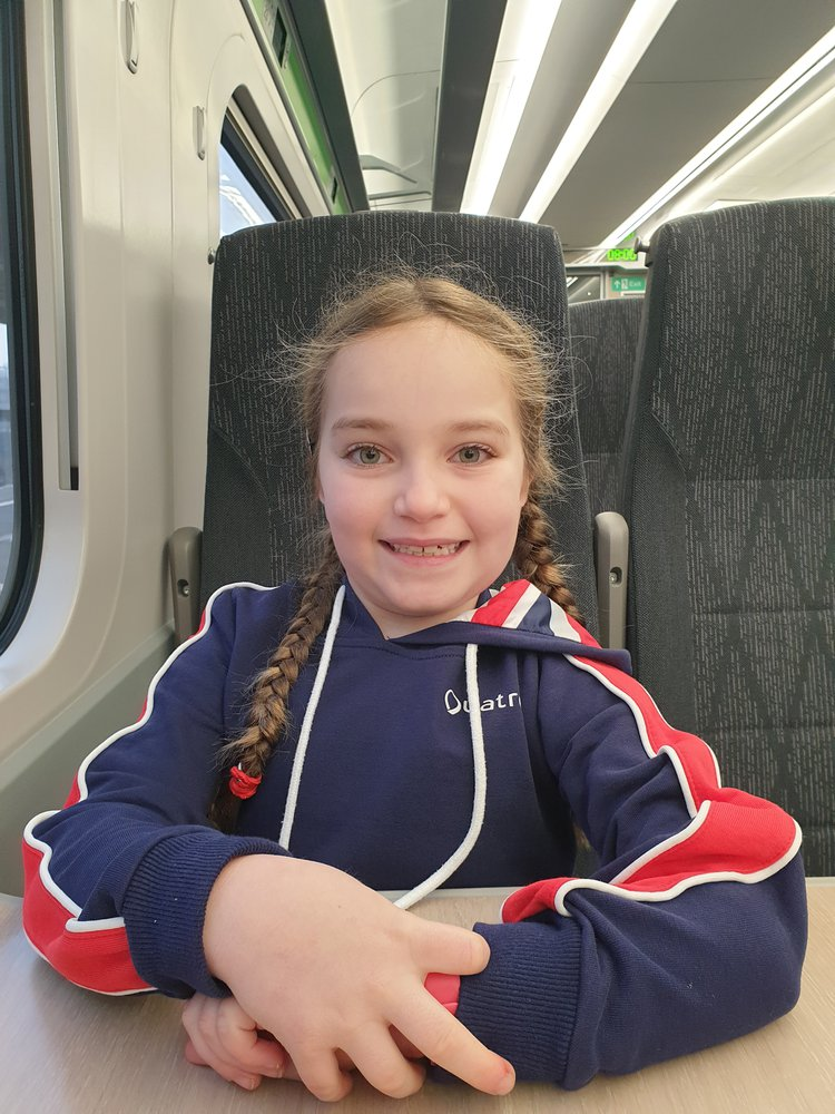 Photo of patient Sara taking the train