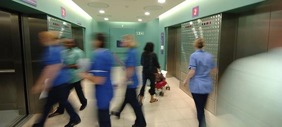 Nurses in blue uniforms in a corridor at GOSH