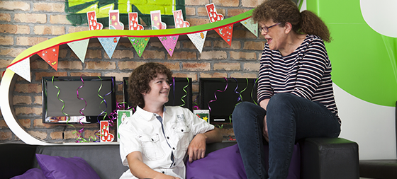 Teenage patient with play specialist on Activity Room sofa at GOSH