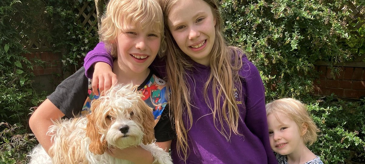 Patients Lucie and Isobel with their brother Jude and dog Lula.