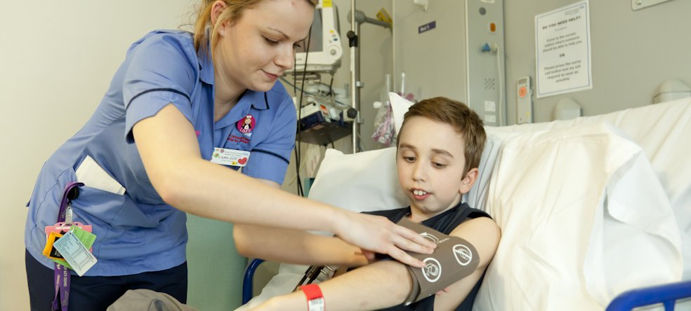 GOSH nurse carrying out a test on a patient