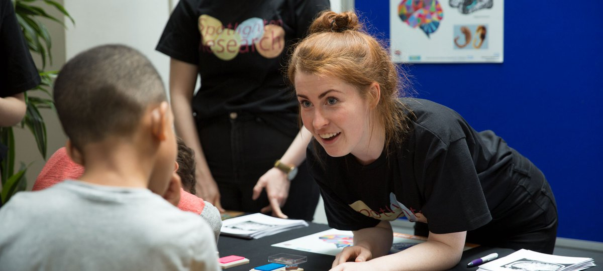 A scientist interacts with young people at the BRC Family Fun Day 2017