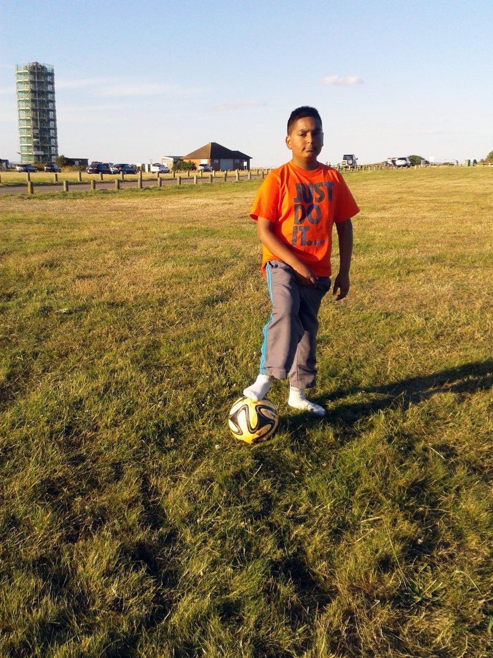 Yaseer playing football
