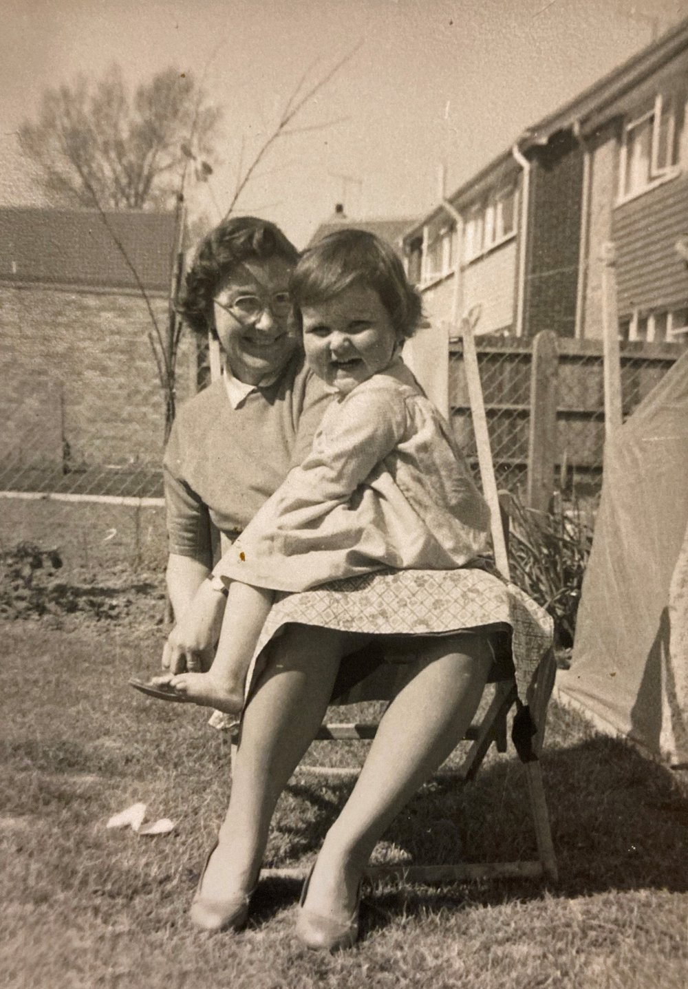 Image showing Christine and a young child sitting on her lap